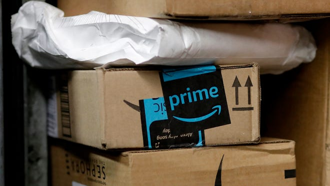 FILE- In this May 9, 2017, file photo, a package from Amazon Prime is loaded for delivery in New York.  Amazon's Prime Day starts July 16, 2018, and will be six hours longer than last year's and will launch new products. (AP Photo/Mark Lennihan, File) ORG XMIT: NYBZ437