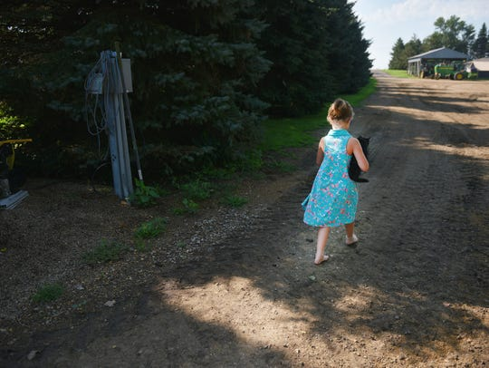 Elliette Kontz, 6, walks around the family farm Wednesday,