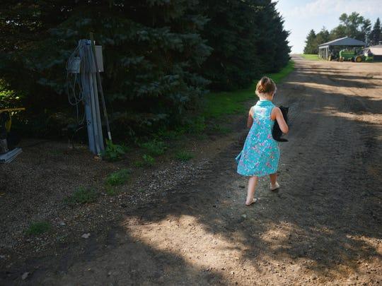 Elliette Kontz, 6, walks around the family farm Wednesday,
