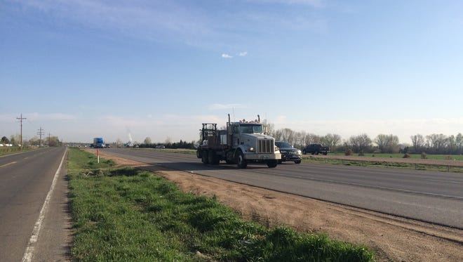 A truck travels southbound on Interstate 25 Thursday between East Harmony Road and Colorado Highway 392. A Milliken woman was shot while driving in the area Wednesday evening.