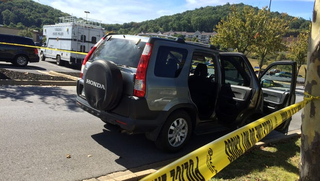 Virginia State Police are investigating a self-inflicted shooting that took place in the parking lot of a Wal-Mart in Staunton Wednesday, Sept. 16 2015.  The male subject was transported to Augusta Health and then flown on to UVA Medical Center for treatment of serious injuries. The incident involved a traffic stop of this Honda CR-V with West Virginia tags at approximately 12:20 p.m. Police were on the lookout for a vehicle matching this description.