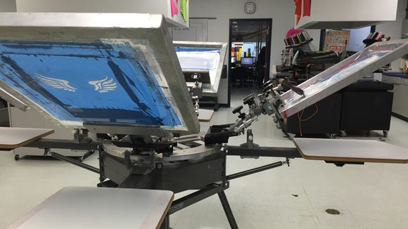 San Elizario High School students use the school print shop to design and print T-shirts for school clubs and sports.