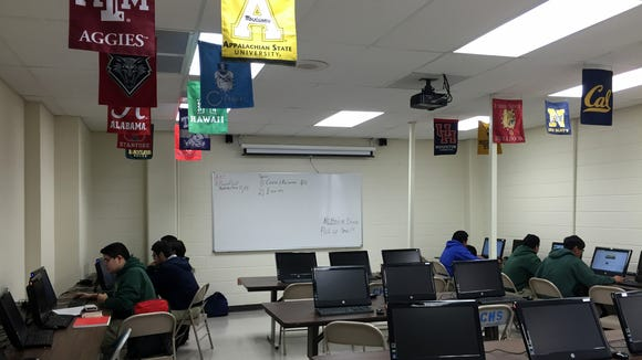 Cathedral High School students take an online college art appreciation class.