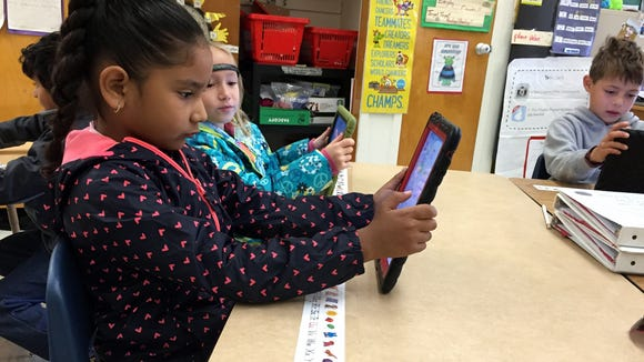 Schuster Elementary School students play a coding game on class iPads.