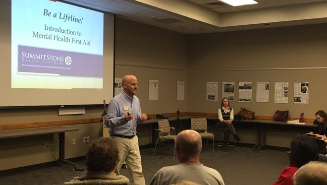 Chris Fine, development specialist with SummitStone Health Partners of Fort Collins, leads a mental health first aid training Thursday, Jan. 21, 2015, in the Coloradoan's community room.