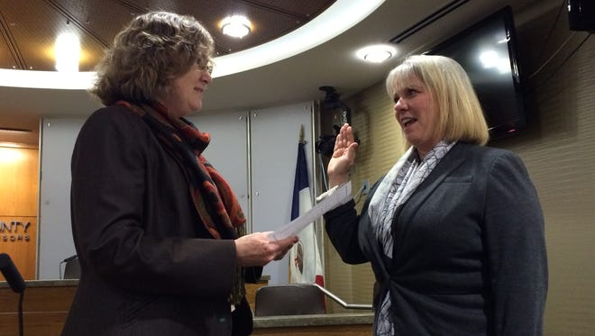 Lisa Green-Douglass, right, is sworn in to the Johnson County Board of Supervisors by County Attorney Janet Lyness on Wednesday afternoon.
