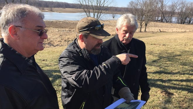 Art Grisez, from left, Colby Bartlett and Del Bartlett go over plans for Ouiatenon Preserve, roughly 200 acres between South River Road and the Wabash River where the site of the original Fort Ouiatenon was. Colby and Del Bartlett are with the Tippecanoe County Historical Association. Grisez is treasurer of the Roy Whistler Foundation, a Lafayette nonprofit foundation that gave more than half of the $1.1 million it took to buy the property.