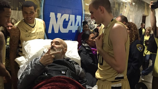 Oakland's Max Hooper talks with his dad, Chip, who's ill and made his first game of the season on Senior Night Feb. 26 in Rochester.