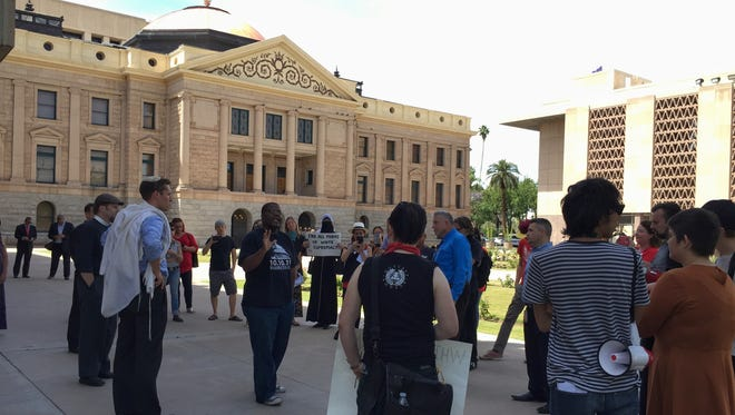 Black Lives Matter protesters gather outside the Arizona State Capitol on Thursday, April 14, 2016.