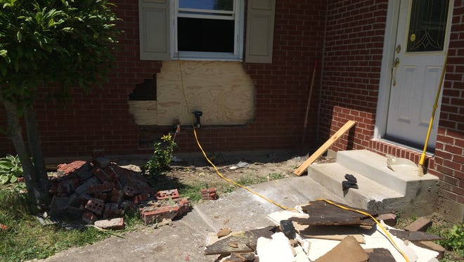 Repairs had begun Monday at a home damaged by a vehicle Sunday night.