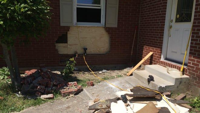 Repairs had begun Monday at a home damaged by a vehicle Sunday night.
