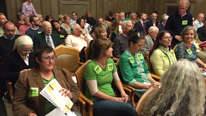 Residents for and against expanding tourist rentals in neighborhoods packed Tuesday's City Council meeting