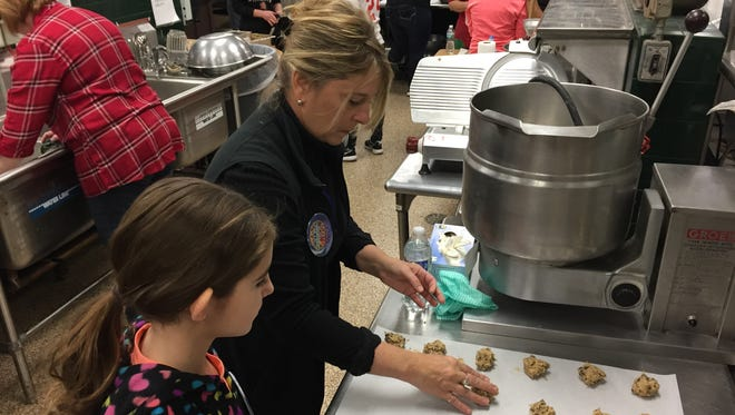Jeanine Hastings of Nyack  and Ceili Romano of Pearl River bake cookies at Rockland BOCES Culinary Arts facility in West Nyack to support Baking Memories 4 Kids, Dec. 10, 2016.