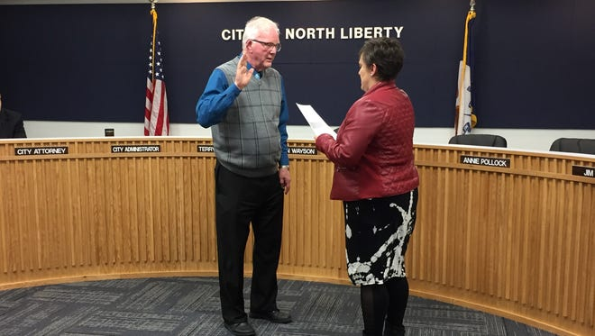 Terry Donahue is sworn in as North Liberty's mayor after the council voted to appoint him on Tuesday, Feb. 28, 2017.