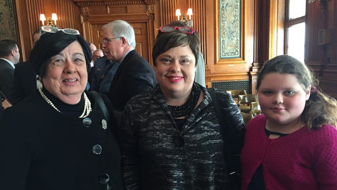 From left, Carol Silvey, Christena Silvey Coleman and Camille Coleman stand together in the Senate Lounge in the Missouri Capitol on March 15, 2017, in Jefferson City. Minutes before, a Senate committee gave unanimously approval for Carol Silvey to join the Missouri State University Board of Governors.