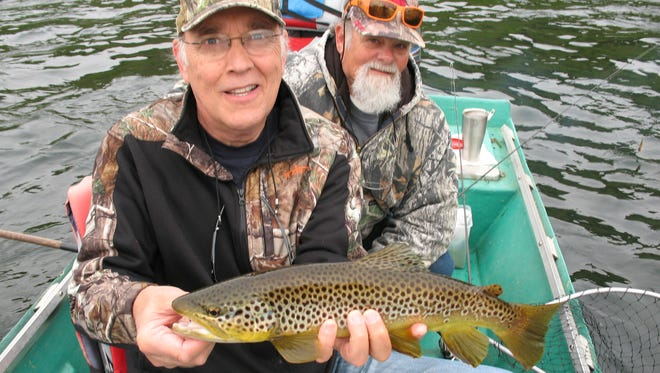 Rob Simbeck of Nashville with 19-inch brown trout he caught with guide Ron Armagost on White River near Lakeview, Ark.