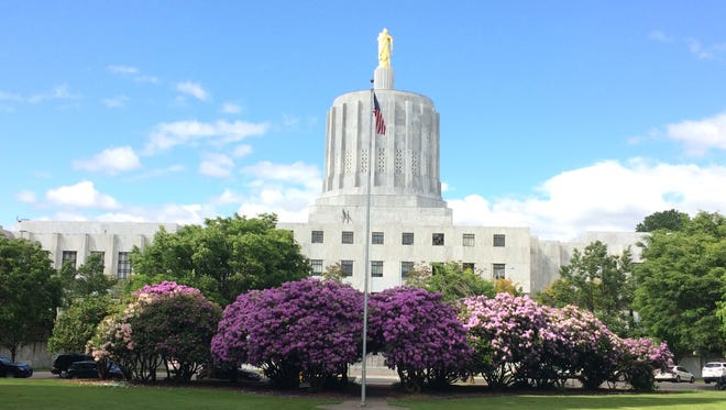 Oregon Capitol with rhododendron in June.