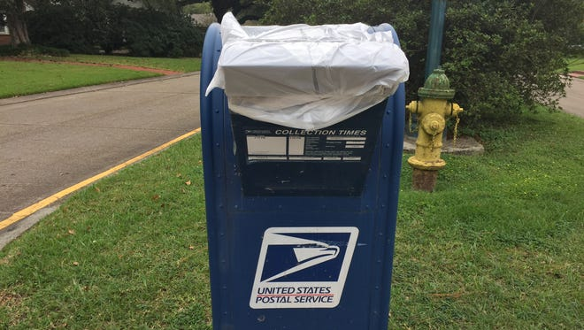Residents have noticed blue collection mailboxes, like this one on West St. Mary Boulevard, have been covered.
