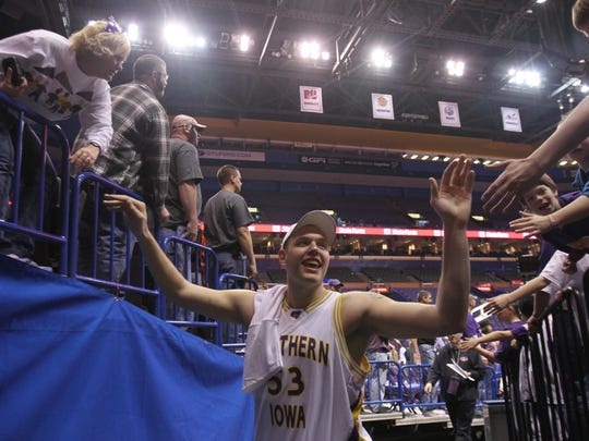 UNI's Jordan Eglseder gives high fives as he leaves the court after their 67-52 victory over Wichita State during the Missouri Valley Conference Tournament Championship game at the Scottrade Center in St. Louis on March 7, 2009.