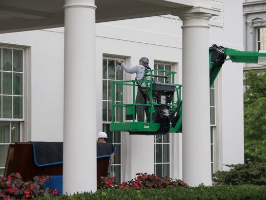 Workers continue renovations on the West Wing of the