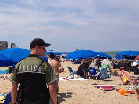 Seasonal officer Marc Glenn patrols the beach in Rehoboth Beach in this file photo.
