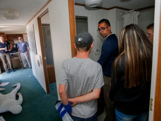 Bloomfield Police Department Det. Orlando Moreno, right, gives his cadets pointers as they process a simulated homicide scene Thursday during the Junior Law Enforcement Academy at Safety City in Kirtland.