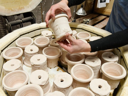 Joel Cherrico is glazing and firing the 159 pots he