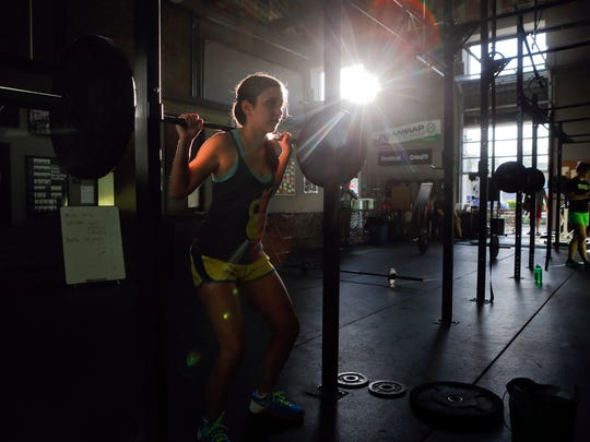 Natalie Magan lifts while working out in a class at CrossFit Riverfront in Wilmington's Riverfront section.