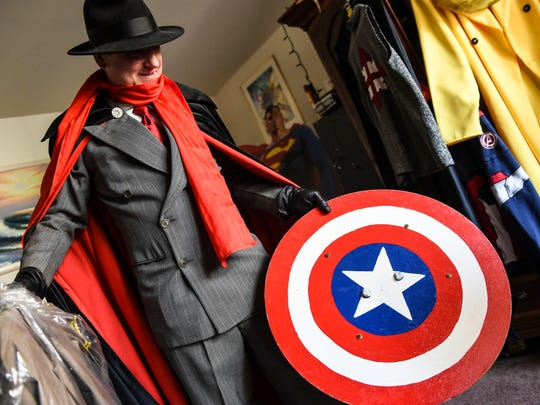 "Jeffrey Lippy, dressed as one of his favorite characters The Shadow, talks about a ""Captain America"" shield his father helped him make in his home in Marietta, Lancaster County."
