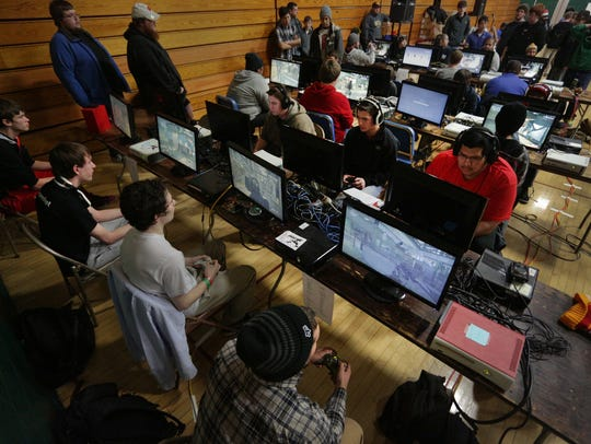 Competitors play at the Evercon gaming convention at D.C. Everest Junior High School in 2013.