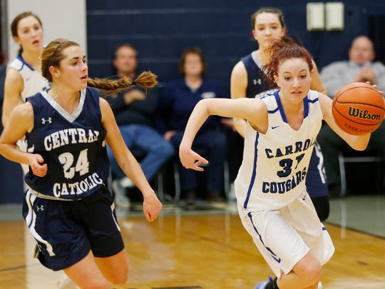 Macy Willoughby of Carroll steals the ball from Emma Gerrety of Central Catholic with less than a minute remaining in regulation in the girls basketball sectional #38 Saturday, February 4, 2017, in Lafayette. Carroll defeated CC 35-30.