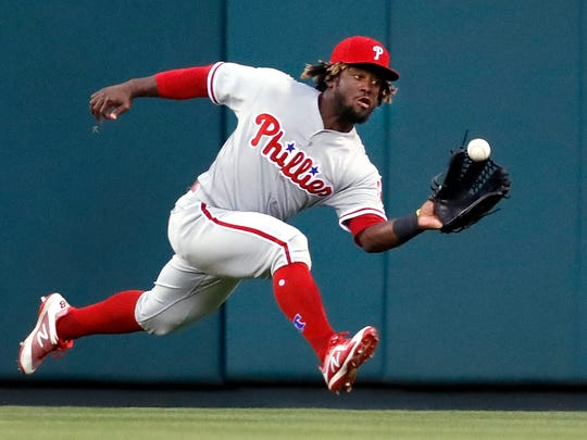 Philadelphia Phillies center fielder Odubel Herrera catches a fly ball against the St. Louis Cardinals, Thursday, May 17, 2018, in St. Louis.