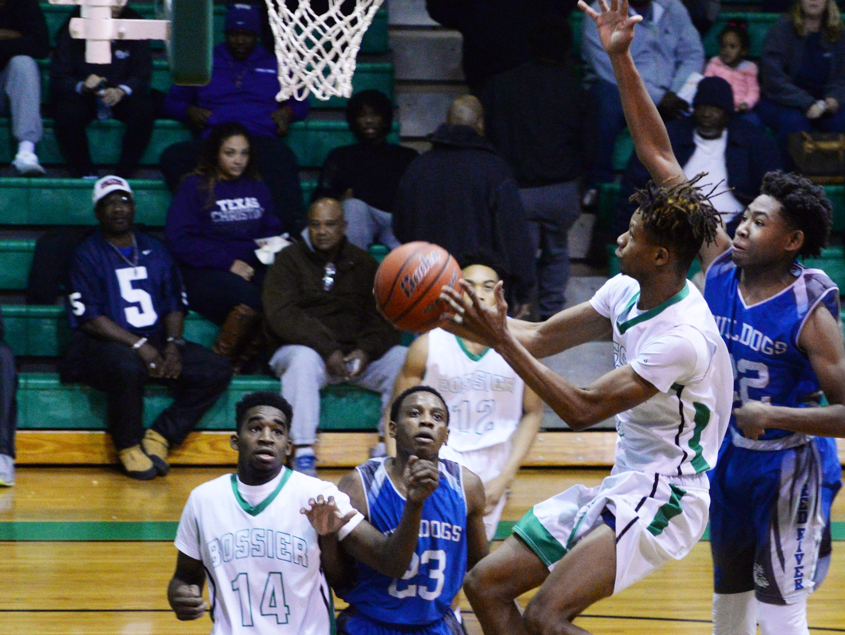 Bossier's TyBo Wimberly tries to get the ball in the basket during their game against Union Parish Friday evening.