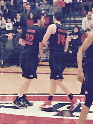 St. Cloud State senior Scottie Stone is congratulated by teammate Andy Foley late in his team's win over Augustana Saturday night at Halenbeck Hall.
