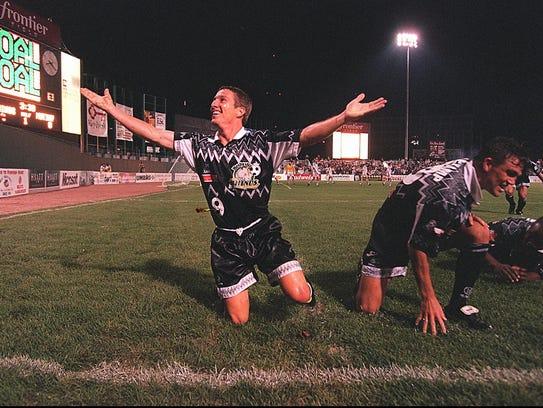Forward Doug Miller, reacting to scoring a goal in