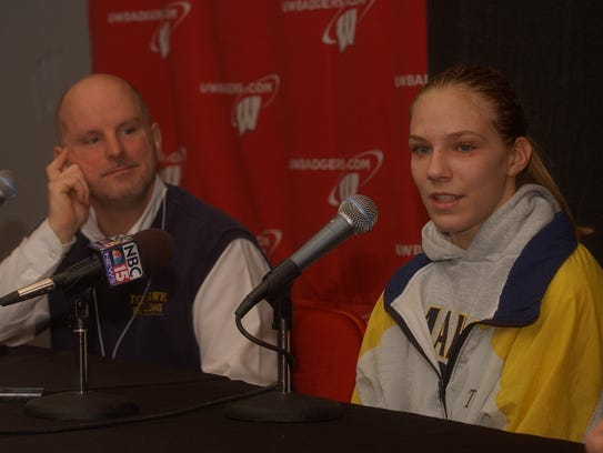 Alyssa Lampe answers questions from reporters alongside former Tomahawk coach Kurt Weyers in 2004 after Lampe became the first girl to compete in the WIAA state wrestling tournament.