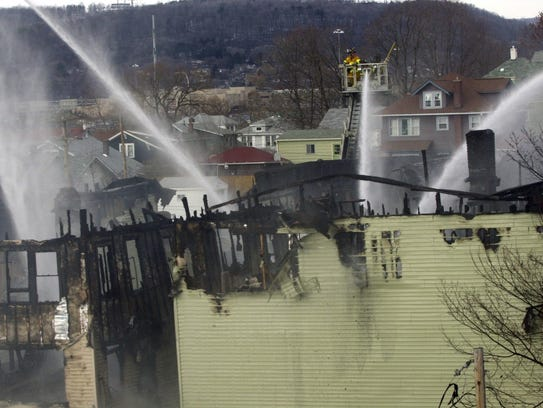 Firefighters battle a blaze in January 2002 that damaged
