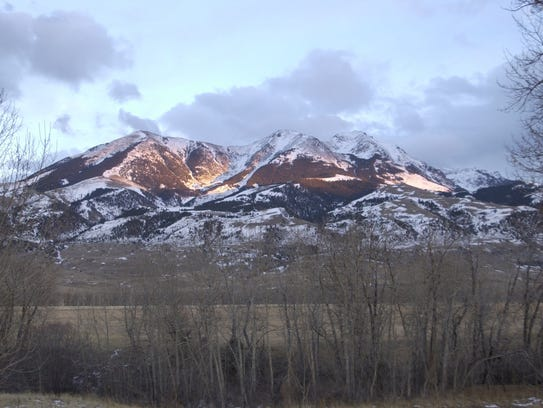 Light catches the west slopes of Emigrant Peak in the