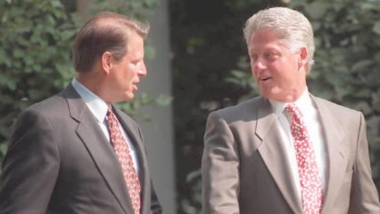 """Bill Clinton and Al Gore walk to Rose Garden ceremony marking two-year anniversary of the """"reinventing government"""" National Performance Review, Sept. 7, 1995, Washington, D.C."""