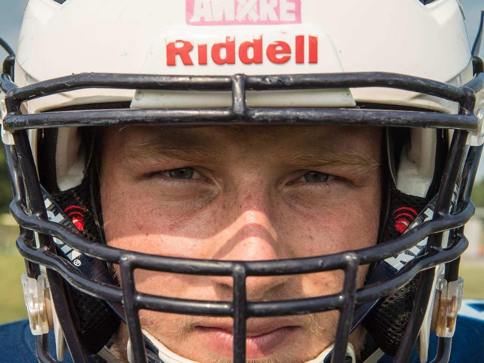 Maple Valley senior Marcum Terpening with new helmet with sensors built in to help avoid concussions .