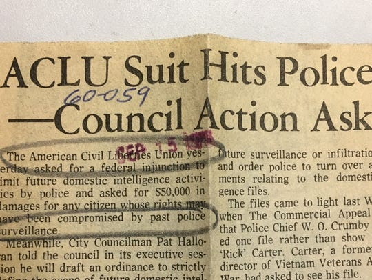 A news clipping from 1976 about police surveillance