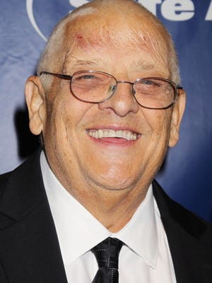 In this Nov. 13, 2014 photo released by Starpix, WWE wrestler Dusty Rhodes, whose real name is Virgil Runnels, poses at the Joe Torre Safe at Home Foundations 12th Annual Gala in New York. The WWE said Runnels died Thursday, but a spokesman declined to say where or how he passed away, saying the family had not authorized the release of that information. He was 69.
