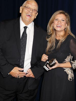 In this Nov. 13, 2014 photo released by Starpix, WWE wrestler Dusty Rhodes, left, whose real name is Virgil Runnels, poses with his daughter Kristin Ditto at the Joe Torre Safe at Home Foundations 12th Annual Gala in New York. The WWE said Runnels died Thursday, but a spokesman declined to say where or how he passed away, saying the family had not authorized the release of that information. He was 69.