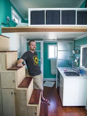 Jared Stoltzfus, inside the home owned by he and his wife, Traci.