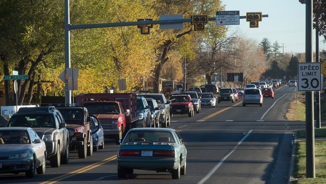 Evening traffic waits to proceed northbound on Lemay Avenue near the intersection of Vine Drive in this file photo. A Fort Collins project to realign Lemay could receive funding through a sales tax proposal being considered by Larimer County officials.