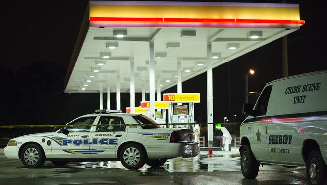 MASS SHOOTINGS: Law enforcement works the scene of a shooting in June at a Circle K in the 1600 block of Cape Coral Parkway.