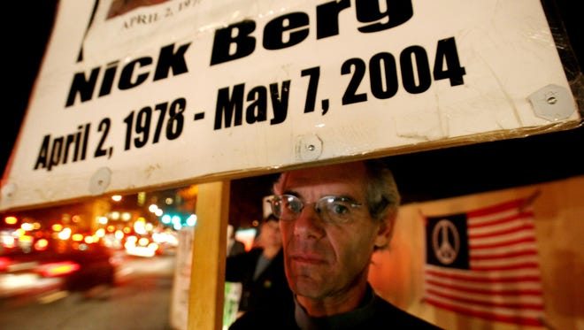 Michael Berg, father of slain businessman Nick Berg who was beheaded in Iraq in 2004, pickets with other war protesters along Delaware Ave. in Wilmington in November 2005.