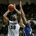 Caleb Swanigan with a shot over Jordan Dickerson of Penn State Wednesday, January 13, 2016, at Mackey Arena. Purdue defeated Penn State 74-57.