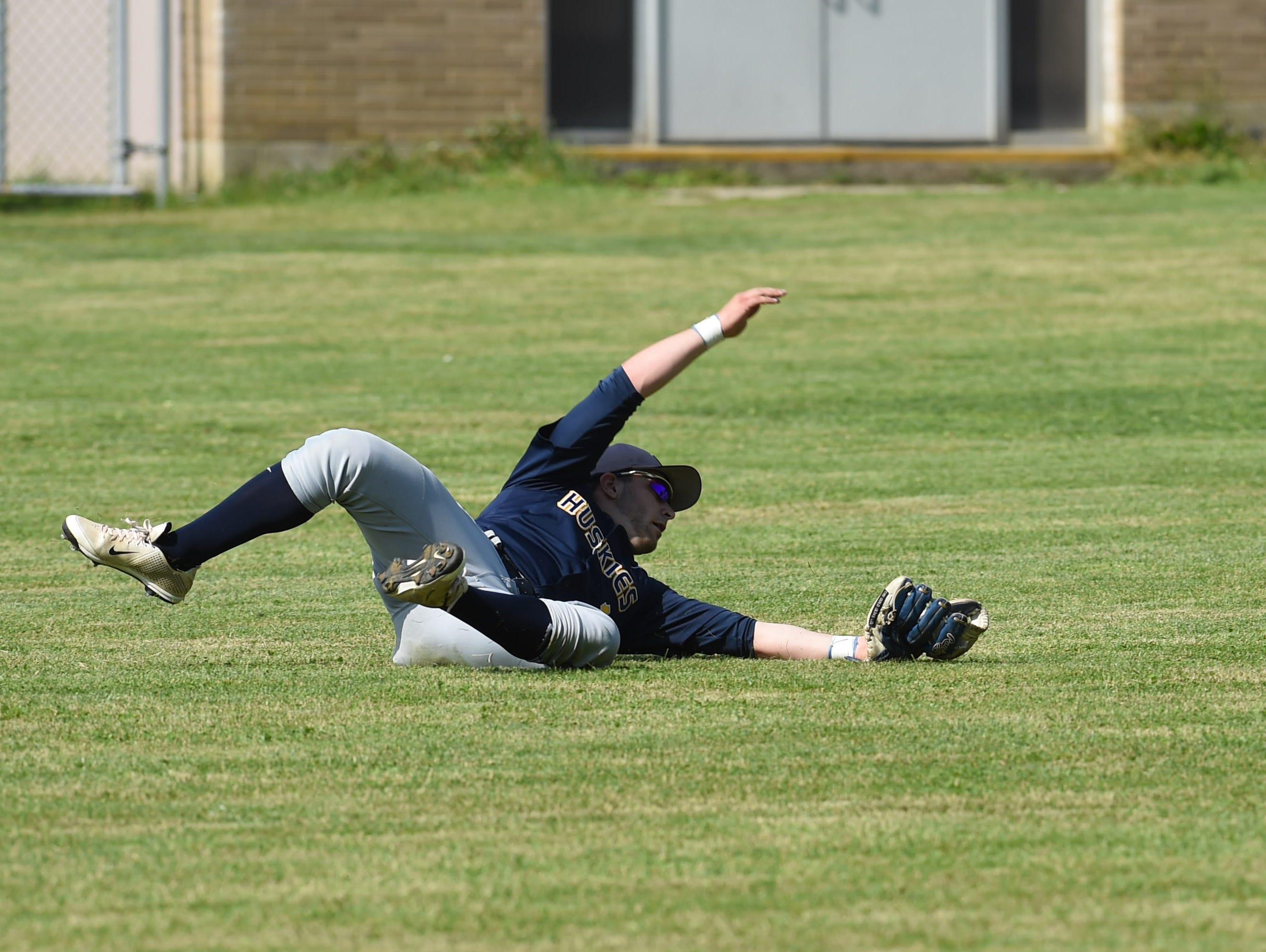 Highland senior outfielder Mike Malhiero makes a diving catch of a foul ball during a game last season against Spackenkill.