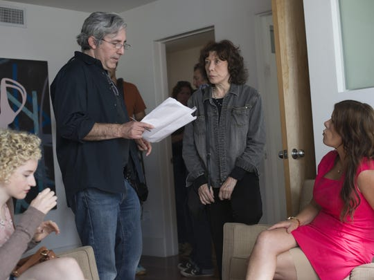"Julia Garner (left to right), writer/director Paul Weitz, Lily Tomlin and Marcia Gay Harden on the set of ""Grandma."""